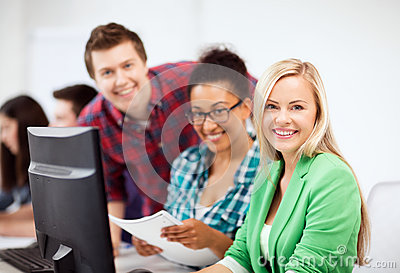 Students with computer studying at school