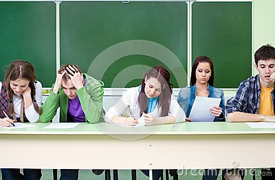 Students on exam  in class