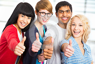 Students giving the thumbs-up sign