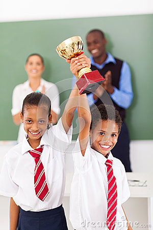 Students holding trophy