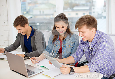 Students with laptop, notebooks and tablet pc