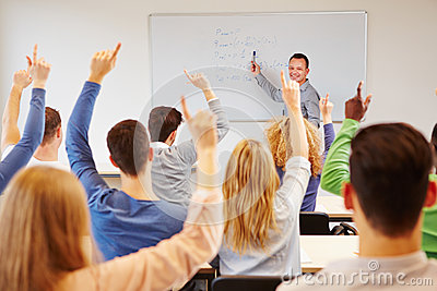 Students lifting hands in college