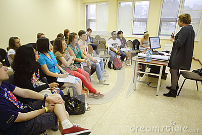 Students listen to lecturer at Global Youth Voice Editorial Stock Image