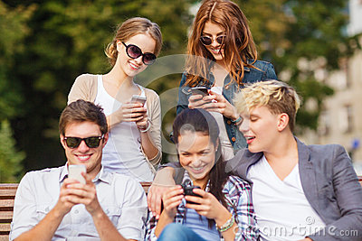 Students looking at smartphones and tablet pc