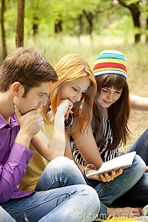 Students at outdoor doing homework.