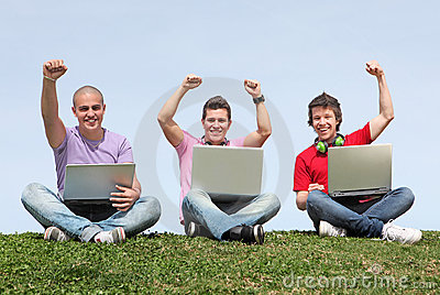 Students outdoors with laptops