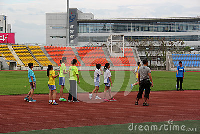 Students practise running In the sports center
