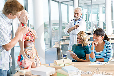 Students with professor and human anatomical model