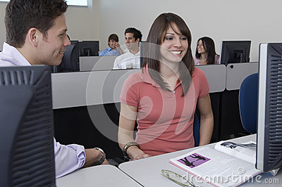 Students Sitting Together At Computer Desk