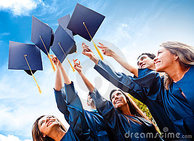Students throwing graduation hats