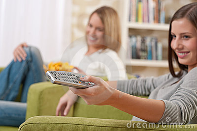 Students - Two Female Teenager Watching Television Royalty Free Stock Photos - Image: 11838158