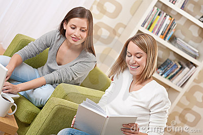 Students - Two teenage girls with laptop and book