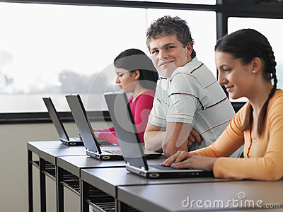 Students Using Laptops In Computer Class