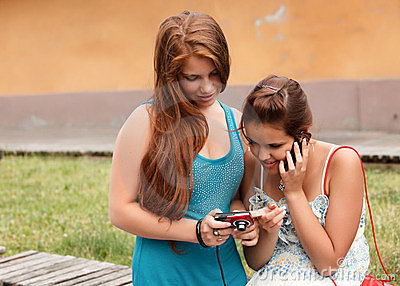 Students Using Mobile Phone and photo camera