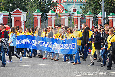 Students walking carrying a long banner Editorial Stock Photo