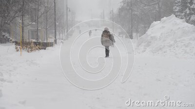 Students walking in snowstorm to class stock video footage