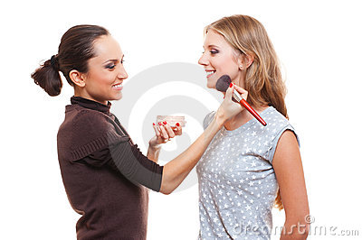 Studio picture of make up artist and young woman