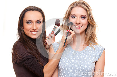 Studio picture of smiley make up artist and client
