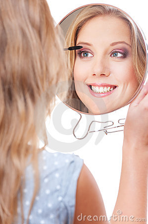 Studio picture of smiley young woman with miror
