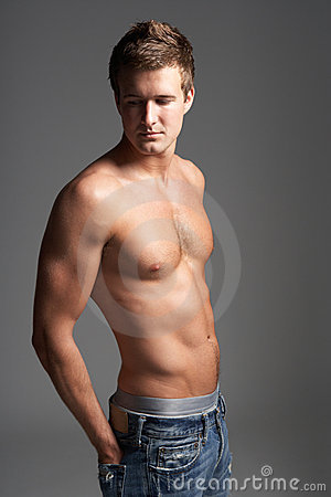 Studio Portrait Of Bare Chested Muscular Young Man