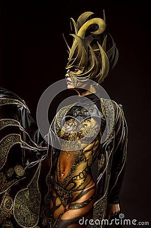 Studio portrait of beautiful model with fantasy golden butterfly body art Stock Photo