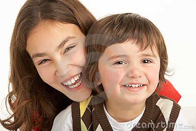 Studio Portrait Of Brother And Sister