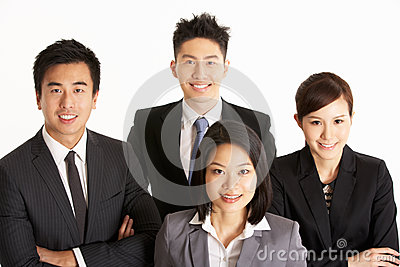 Studio Portrait Of Chinese Business Team
