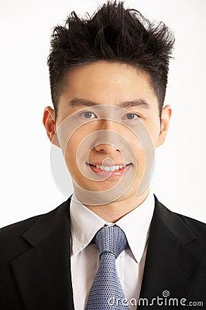 Studio Portrait Of Chinese Businessman