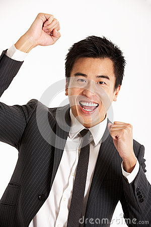 Studio Portrait Of Chinese Businessman Celebrating