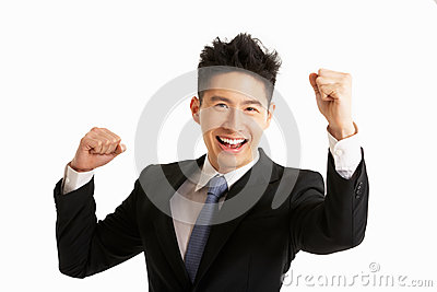 Studio Portrait Of Chinese Businessman Celebrating
