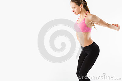 Studio portrait of cute young fitness girl doing yoga exercises.