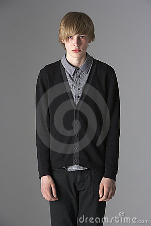 Studio Portrait Of Fashionably Dressed Teenage Boy