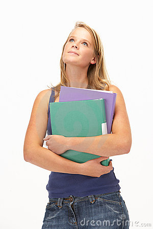 Studio Portrait Of Female Student Holding Folders