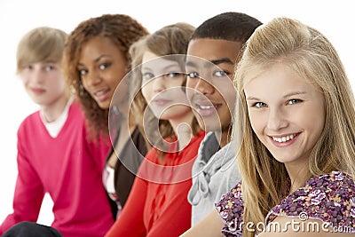 Studio Portrait Of Five Teenage Friends Standing I