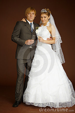 Studio portrait of groom and bride