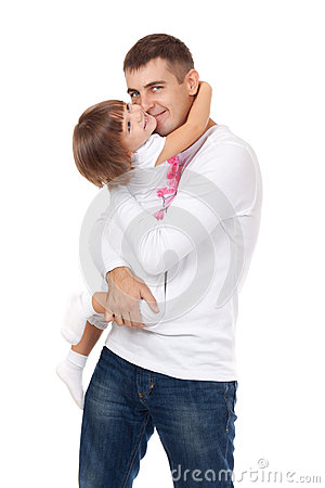Studio portrait of loving father hugging his child