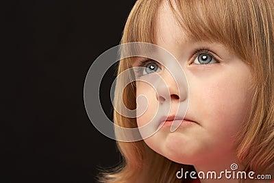 Studio Portrait Of Sad Young Girl