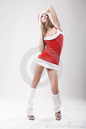 Studio portrait of a sexy woman dressed as Santa