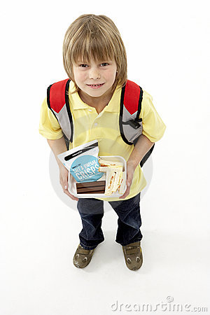 Studio Portrait of Smiling Boy Holding Lunchbox