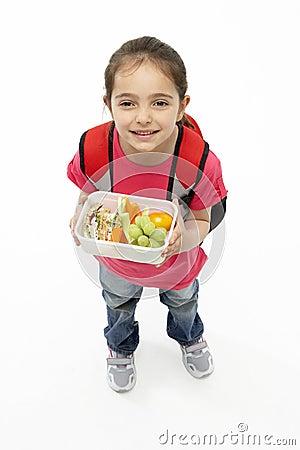 Studio Portrait of Smiling Girl Holding Lunchbox