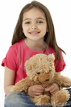 Studio Portrait Of Smiling Girl with Teddy Bear