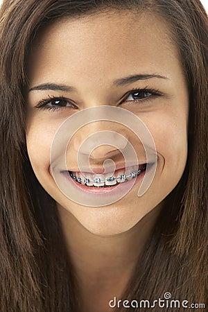 Studio Portrait of Smiling Teenage Girl