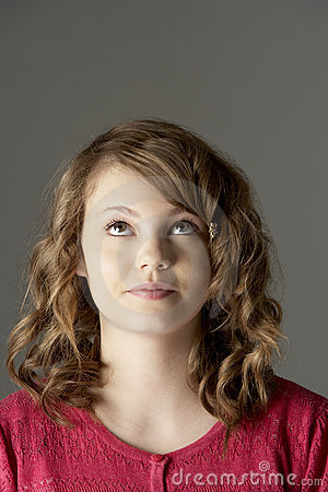 Studio Portrait Of Teenage Girl Looking Up