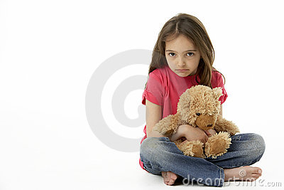 Studio Portrait Of Unhappy Girl with Teddy Bear