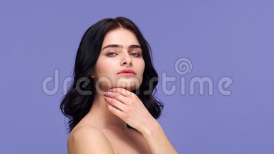Studio portrait of young and beautiful brunette woman over background. Skin care, health, makeup and cosmetics. Studio portrait of young and beautiful brunette stock footage
