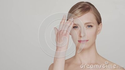 Studio portrait of young and beautiful woman over grey background stock video