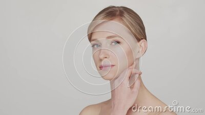 Studio portrait of young and beautiful woman over grey background stock video footage