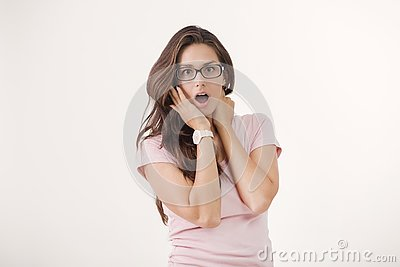 Studio portrait of young brown-haired woman with shocked facial expression Stock Photo