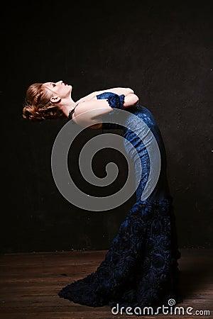 Free Studio Shoot Of Posing Woman In Long Blue Dress. Retro Style. Royalty Free Stock Photos - 64090008
