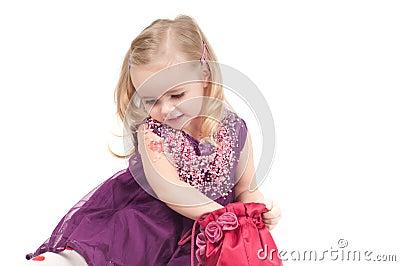 Studio shot of baby girl in gala dress